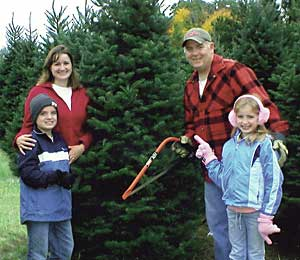 Family cutting a tree